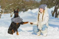 Joyful children playing in snow. Two happy girls having fun outside winter day.  Royalty Free Stock Images