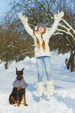 Joyful children playing in snow. Two happy girls having fun outside winter day Royalty Free Stock Photography