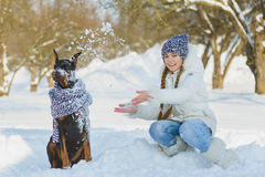 Joyful children playing in snow. Two happy girls having fun outside winter day.  Royalty Free Stock Photography
