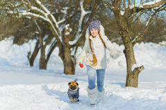 Joyful children playing in snow. Two happy girls having fun outside winter day Royalty Free Stock Photo