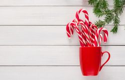 Joyful christmas background with traditional candy cane lollipops Stock Photos