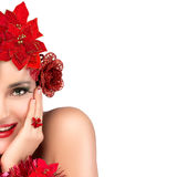 Joyful Christmas Girl. Beauty Winter Woman in red. Holiday Hairs Royalty Free Stock Photo