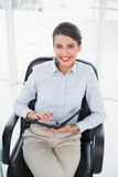 Joyful classy brown haired businesswoman filling her agenda Royalty Free Stock Photo