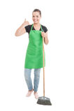 Joyful cleaning girl doing a call gesture Royalty Free Stock Images