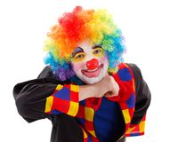 Joyful clown prop in air. Joyful clown smiling, prop his head in the air Stock Images