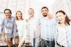 Joyful colleagues standing in the office stock photo