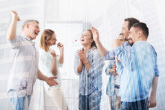 Joyful colleagues standing together in the office royalty free stock images