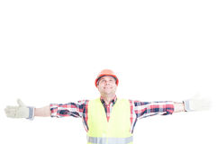Joyful constructor standing with arms wide open Royalty Free Stock Photography