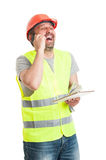 Joyful constructor talking on cellphone and laughing Stock Photography