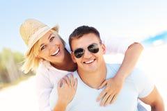 Joyful couple at the beach Stock Images