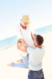 Joyful couple at the beach Stock Images