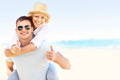 Joyful couple at the beach Stock Photos