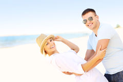 Joyful couple at the beach Stock Photography