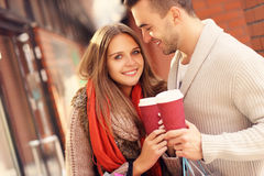 Joyful couple with coffee shopping in the mall Stock Photography
