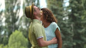 Joyful couple dancing and hugging, gently touching each other with their noses. Stock footage stock video