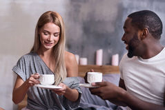 Joyful couple eating together in the morning Stock Image