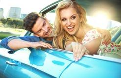 Joyful couple enjoying the fast ride stock image