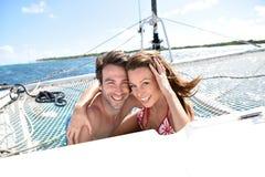 Joyful couple enjoying sailing cruise Royalty Free Stock Image