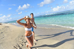 Joyful couple enjoying summer holidays in tropics Royalty Free Stock Photos