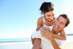 Joyful couple fooling around on thebeach Stock Photo