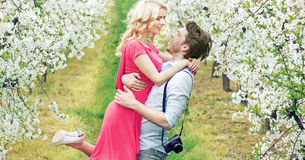 Joyful couple in the fragrant orchard Royalty Free Stock Images