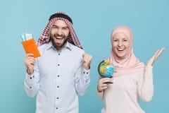 Joyful couple friends arabian muslim man wonam in keffiyeh kafiya ring igal agal hijab clothes isolated on blue