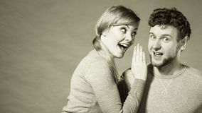 Joyful couple gossip to each other. Royalty Free Stock Photos