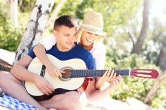 Joyful couple and guitar royalty free stock photography