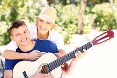 Joyful couple and guitar Stock Image