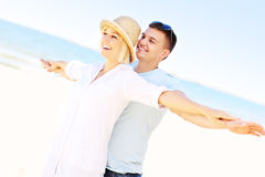 Joyful couple having fun at the beach Royalty Free Stock Photography