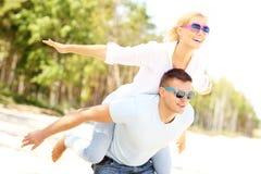 Joyful couple having fun at the beach Stock Photo