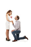 Joyful couple holding red heart isolated Royalty Free Stock Image