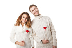 Joyful couple holding red hearts and laughing Royalty Free Stock Photo