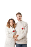 Joyful couple holding red hearts and laughing Royalty Free Stock Photos