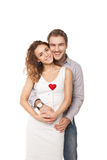 Joyful couple holding red hearts and laughing Stock Image