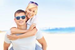 Joyful couple hugging at the beach Royalty Free Stock Photos