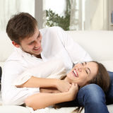 Joyful couple joking and laughing at home Royalty Free Stock Images