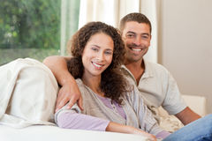 Joyful couple looking at the camera Royalty Free Stock Photos
