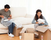 Joyful couple packing glasses together Stock Photo