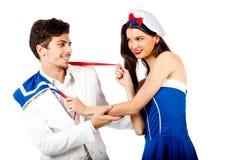 Joyful couple roleplay sailor uniform. Joyful young couple enjoy roleplay in sailor uniform and elegant suit. Isolated on white background. High resolution Royalty Free Stock Images