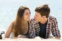 Joyful couple on sandy beach Royalty Free Stock Photo