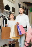 Joyful couple with shopping bags. At boutique Royalty Free Stock Photo