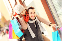 Joyful couple shopping in the city Stock Photo