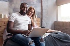 Joyful couple sitting together and enjoying the morning Stock Photography