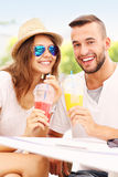 Joyful couple and smoothies in a cafe Stock Photo