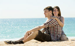 Joyful couple on sunny beach Stock Photography