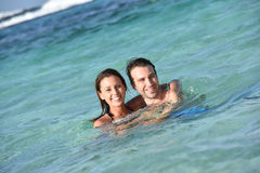 Joyful couple swimming in caribbean sea Royalty Free Stock Images