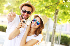Joyful couple taking pictures in the city Royalty Free Stock Photos