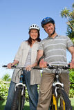 Joyful couple with their bikes Royalty Free Stock Photos