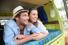 Joyful couple in vintage camping car Royalty Free Stock Image